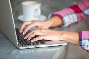Woman hands typing email on laptop keyboard, effective communication, business freedom